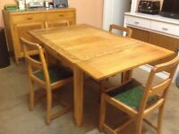 Solid oak extendable dining table, 4 oak chairs and oak sideboard