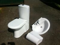 Quality modern bathroom close couple toilet with seat and sink with chrome mixer taps