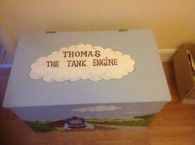 Thomas the tank engine storage box and 2 play sets.