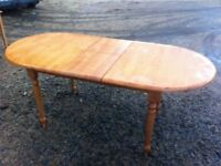 Extending pine dining table in beautiful condition