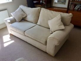 Lovely 2 seater cream sofa