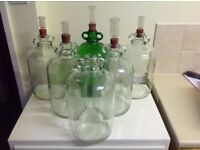 Several 4.5 litre clear glass demijohns for sale