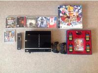 Sony PlayStation 3 with Buzz Quiz TV and other games
