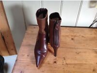 Genuine Christian Louboutin brown suede and leather ankle boots. Size 36.5 (size 4).