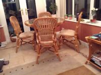 Conservatory cane circular glass top table and 4 chairs