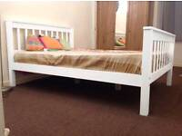 white solidwood beds with high footbord and lower available in all sizes