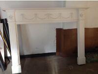 White wood fire surround/mantelpiece and stone fireplace