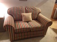 Check two seater sofa with arm sleeves