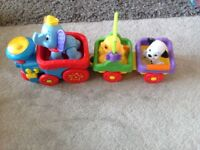 Excellent condition Disney fisher price musical train and animals