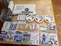 Wii console, Fit board, 11 games, 4 remotes, 4 nunchucks etc