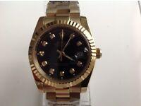 Rolex- date just – all gold – black face