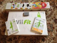Nintendo Wii Fit Board + Rechargeable battery pack + Wii Fit and Wii Fit Plus Games + Accessory Pack