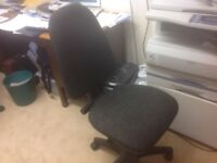 Office chair, charcoal grey fabric, gas lift.