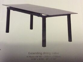 Black Glass Extending Dining Table.