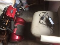 Red mobility scooter fully charged and hardly used very good condition