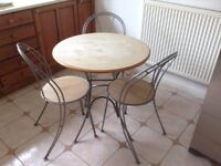 Good condition dining table and 3 chairs