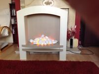 Electric fire in surround
