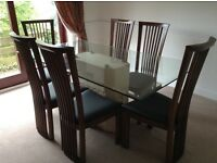 Dining table with 6 high back oak chairs with glass top and marble base