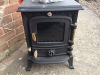 Wood burning stove and liner