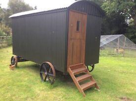 Shepherd Hut For Sale - unused. Cast iron wheels - fully insulated - double glazed hardwood windows