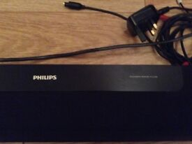 Phillips soundbar speaker HTL2100, wall mountable, black, inc remote control and connecting wires.