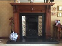 Cast iron tiled fireplace with solid wood surround and tiled hearth - £250