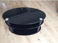 Black oval television stand ideal for 32in t v
