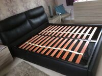 Black soft faux leather European king size bed underneath storage