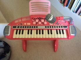 Pink kids keyboard and stool with microphone