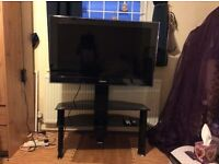STYLISH MODERN GLOSSY BLACK GLASS TV TABLE WITH TWO SHELVES AND TV MOUNT