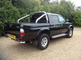 Black L200 very good condition.Leather seats roller cover economy remap 140 bhp