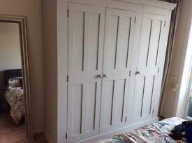 Large triple wooden wardrobe