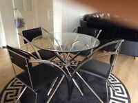 Glass stainless steel table with chairs
