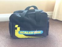 Scalextric bag containing track, cars and handsets etc. Full set.