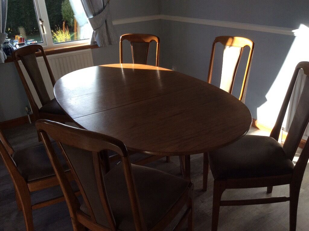Teak 1970's dining table and six chairs.
