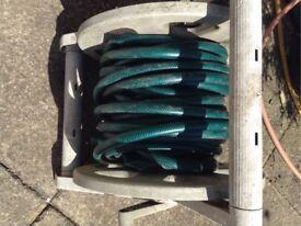 Green garden hose about 20m, Cheap.