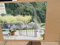 Brand new iron garden arch with gate