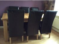 Solid oak extendable dining table & chairs
