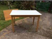 Small solid wood table with white top