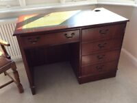 Antique reproduction desk with leather inlay top