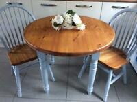 Solid pine table and chairs.