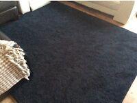 Black rug. 7ft 7 x 6ft 6