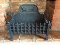 Cast iron fire basket with decorative design. Used for decorative purposes only. As new.