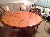 Round extendable wooden table. 6 seater or more. Farmhouse style table. Dining table
