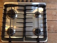 Zanussi gas hob. 4 burners. 2 Cast iron pan supports. Good working condition. Used.