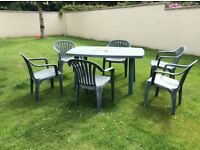 Green plastic table and 6 chairs