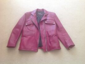Fuschia pink leather jacket in excellent condition.