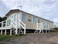 Caravan for sale with front and side decking in Weymouth Dorset on sea view pitch