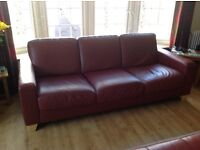 Natuzzi red leather 3 seater sofa with matching footstool