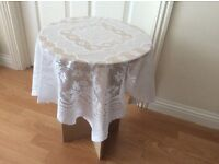 BEDSIDE TABLE & WHITE LACE COVER